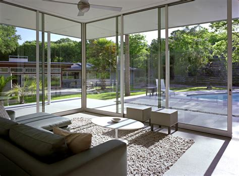 florida room florida room designs living room midcentury with area rug concrete floor beeyoutifullife