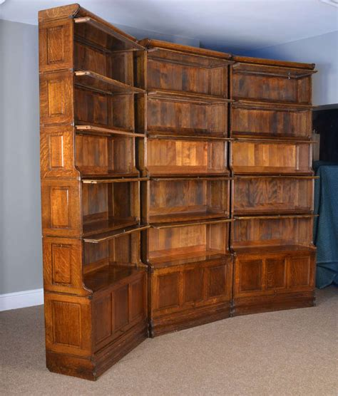 Sectional Bookcase three large oak sectional waterfall barrister bookcases at 1stdibs
