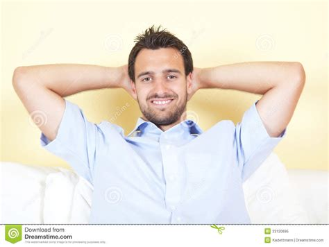 latina couch smiling handsome man at an office royalty free stock photo