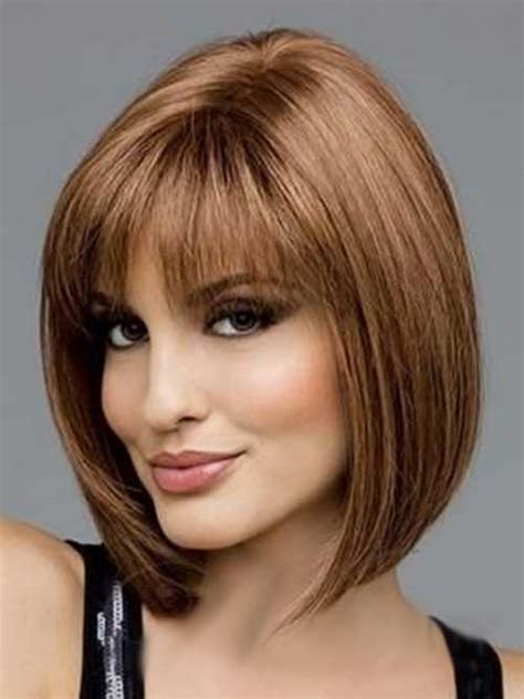 dark brunette bob haircut with wispy bangs and tucked classic bob haircut pictures the best short hairstyles
