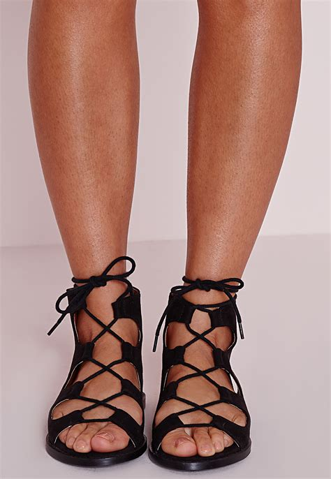 sandals lace up lyst missguided lace up flat gladiator sandals black in