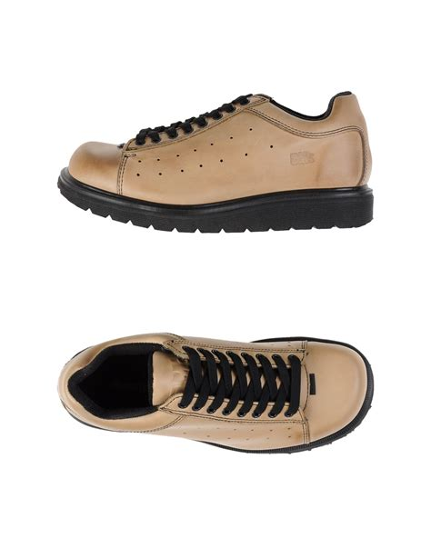 dr low dr martens low tops trainers in beige for sand lyst