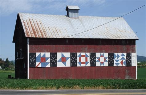 Barn Quilt by Barn With Quilts Painted On The Side Barn Quilts