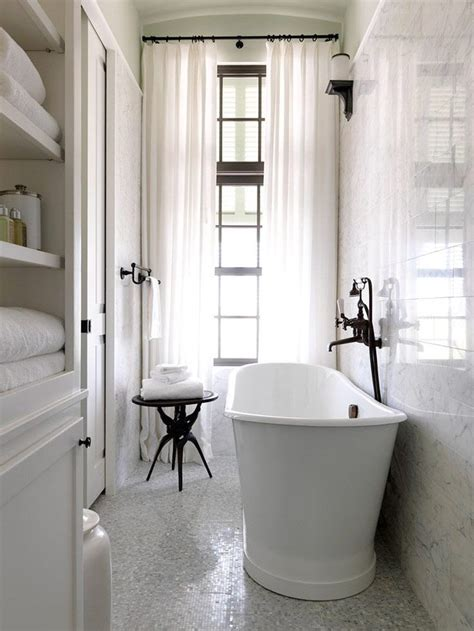 narrow bathroom windows marble mosaic floor marble tile walls narrow deep soaker