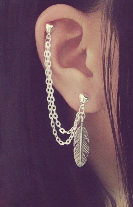 feather cartilage chain earrings tattoos