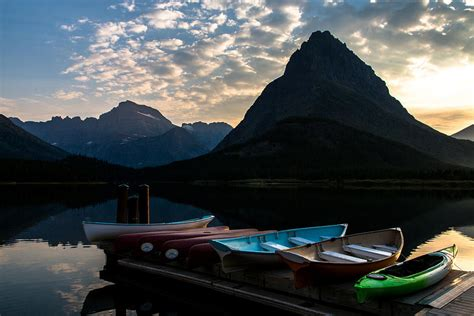 swift lake boat r swiftcurrent lake boat dock photograph by john daly
