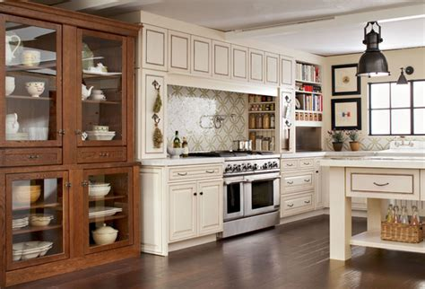 kraftmaid green cabinets kitchen in cognac and canvas with cocoa glaze kraftmaid