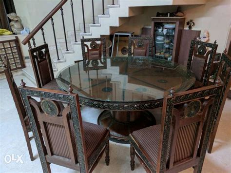 wooden dining table with glass top and 8 chairs