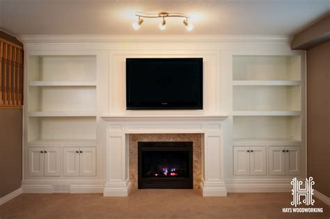 interior entertainment unit with fireplace drainage pipe