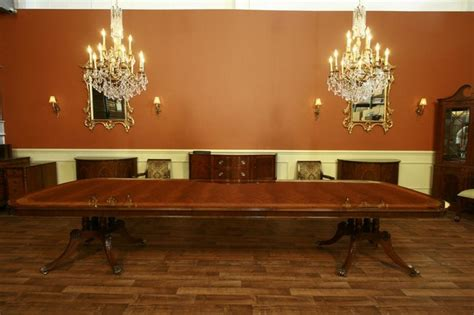 large and mahogany dining room table with 3