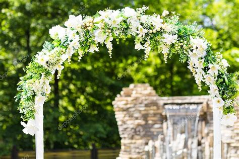 Wedding Arch White by Beautiful White Wedding Arch Decorated With White Flowers