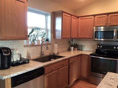builder grade oak kitchen cabinets the feel of a white kitchen without white cabinets