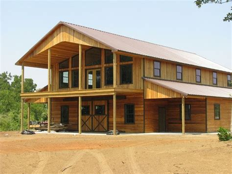 two story pole barn large open patio with cover over the bottom also barn