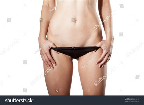 female extremely long pubic hair women undressing her panties shows her stock photo