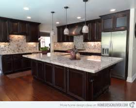This bianco alaska granite kitchen countertop and backsplash