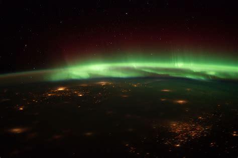 astronauts track northern lights