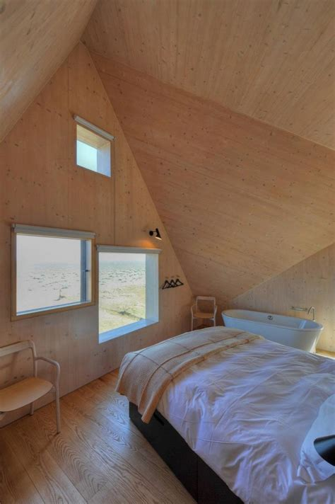bedroom with glass roof unique house with glass wall and geometric roof dune