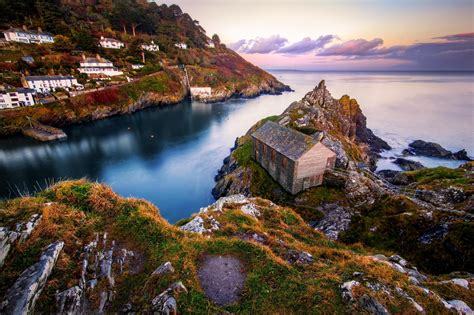 Small Town landscape sea bay rock house sunset evening sky clouds