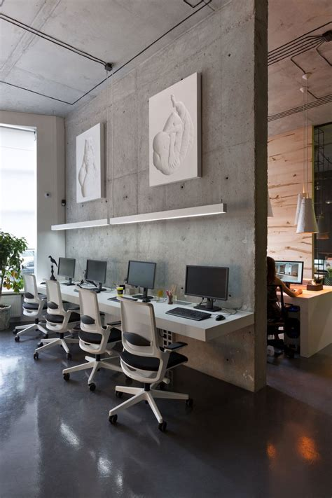 Architectural Office And Showroom Puts An Artistic Spin On Decorating Office Walls