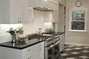 White Kitchen Cabinets With Black Granite Countertops Polished Black Countertops Transitional Kitchen