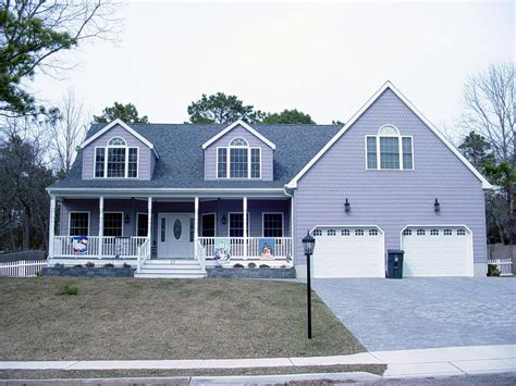 house plans with front porch and dormers cape cod style home with farmers porch two car garage and