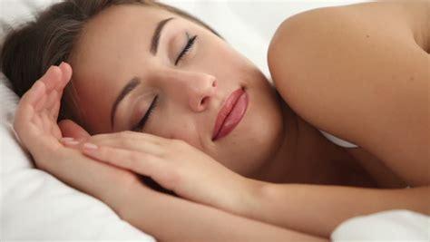 woman sleeping in bed sleeping woman stock footage video shutterstock