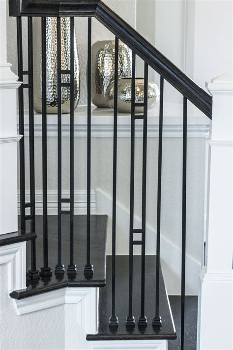 wrought iron banisters this staircase uses high quality wrought iron balusters to