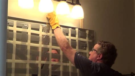 how to remove glass mirror from bathroom wall how to remove a glued bathroom mirror from the wall youtube