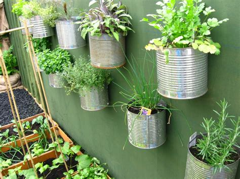 container gardening complete creative projects for growing vegetables and flowers in small spaces books another great way to recycle your cans roots