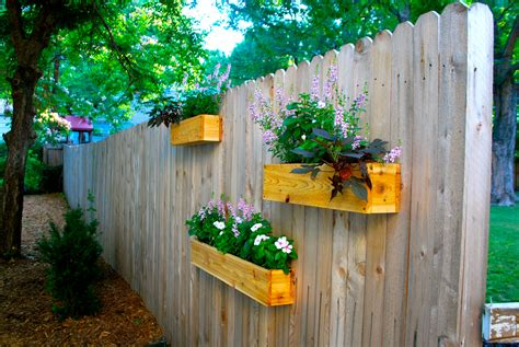 Planters On Fence by Yard Update And Diy Cedar Planter Boxes The Suburban