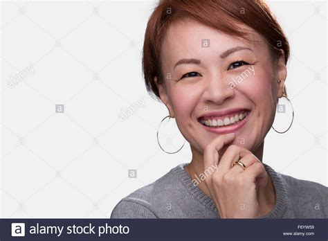 japanese middle age women a headshot of a smiling middle aged japanese woman on a