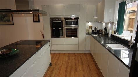 Black Gloss Kitchen With White Worktops white gloss kitchen with black granite worktops worcester