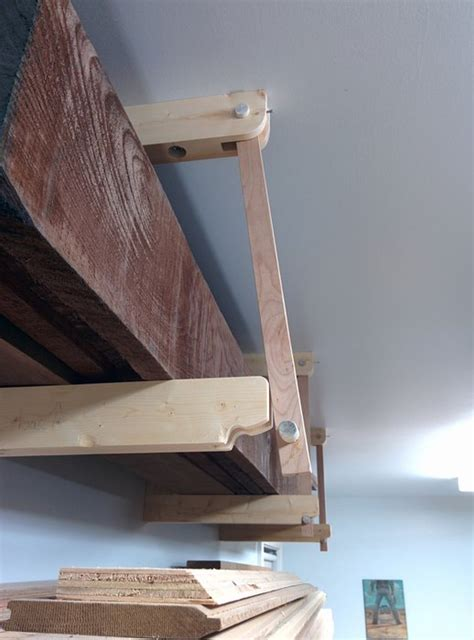 Wall Mounted Lumber Storage Rack by Against Wall Ceiling Mounted Wood Rack By Junado