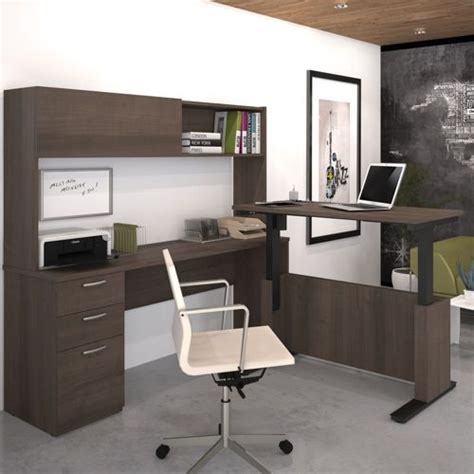 sit stand executive desk tired of sitting for long periods of time stretch it out