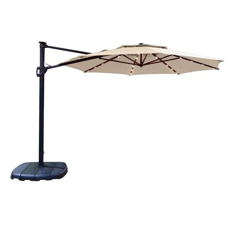 11 Cantilever Patio Umbrella With Base Shop Simply Shade Cantilever Umbrella Offset Pre Lit 11 Ft Patio Umbrella With Base At Lowes
