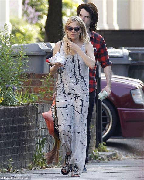 Sienna Miller wears tie dye maxi dress as she goes
