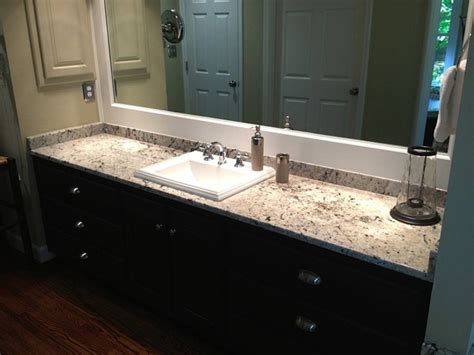 pictures of white granite bathroom countertops delicatus white granite bathroom countertops traditional bathroom birmingham by surface one