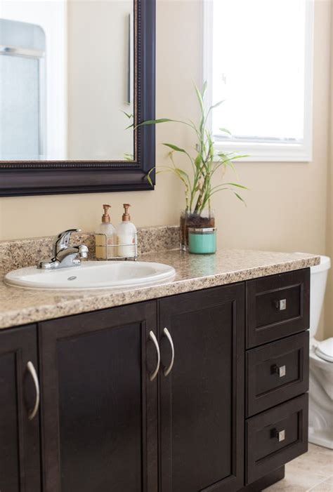 brown bathroom wall cabinet dark brown cabinets with a granite countertop beautifully