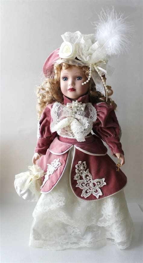 porcelain doll l 1999 camellia garden collection brass key