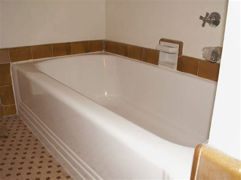 tiling side of bathtub 1930 s tub with side pour plumbing and original floor tile