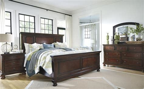 ashley porter king bedroom set porter king panel bed from millennium by ashley furniture