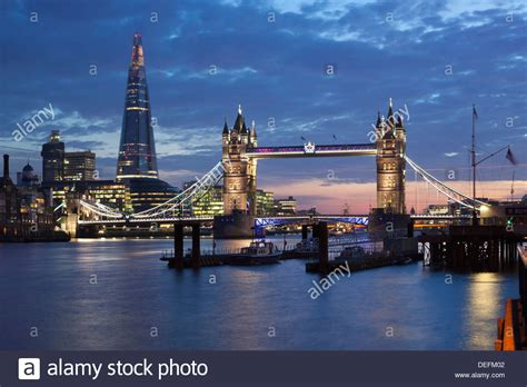 thames river london england oh the places to go the shard and tower bridge on the river thames at night