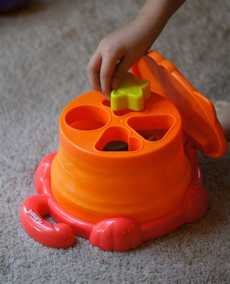 Playskool Pop Up Shape Mainan Anak learn colors and shapes with the pop up shape sorter from playskool not quite susie homemaker