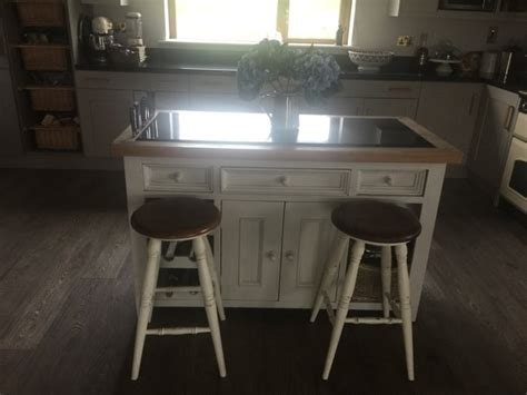 kitchen island with 4 chairs kitchen island with four laura ashley bramley stools for