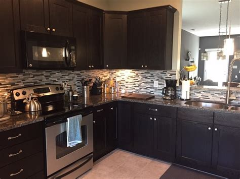 espresso kitchen cabinets with backsplash espresso shaker cabinets with mosaic tile backsplash
