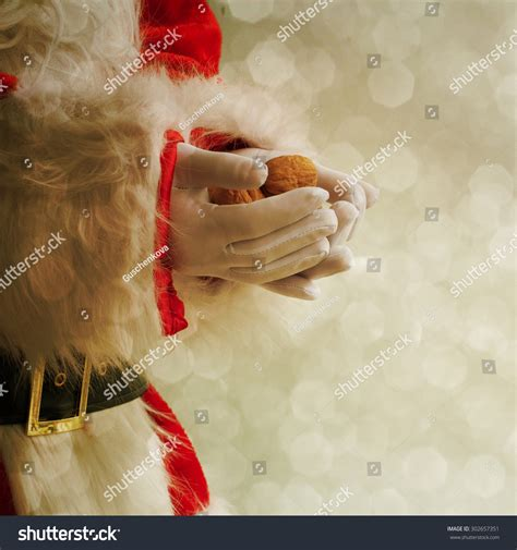 Holding The Nuts santa claus holding nuts stock photo 302657351