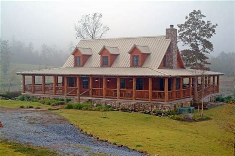 log cabin plans with wrap around porch log cabin with a tin roof and a wrap around porch