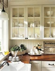 farmhouse kitchen wood countertops glass cabinets