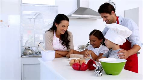 family in kitchen family baking together at home in kitchen stock footage