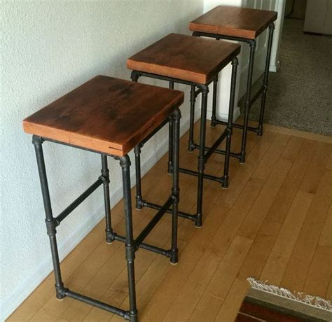 wood bar table and stools reclaimed wood iron pipe bar stools by wrenchmaven on